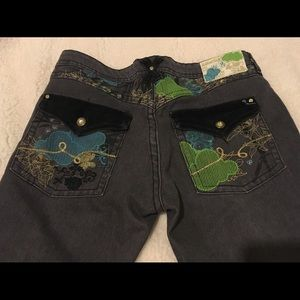 Luxirie  embellished flared/boot cut jeans